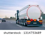 Truck With Cistern On Road....