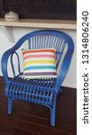 blue cane chair with striped... | Shutterstock . vector #1314806240