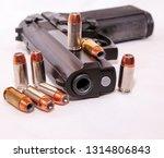 a black 40 caliber pistol with... | Shutterstock . vector #1314806843
