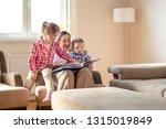 happy mother with children... | Shutterstock . vector #1315019849