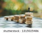 miniature people  businessmen...   Shutterstock . vector #1315025486