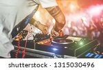 Stock photo dj mixing outdoor at beach party festival with crowd of people in background summer nightlife 1315030496