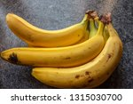 yellow bananas on table | Shutterstock . vector #1315030700
