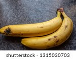 yellow bananas on table | Shutterstock . vector #1315030703