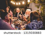 happy family eating and... | Shutterstock . vector #1315030883