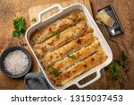 baked meat and vegetables crepe ...   Shutterstock . vector #1315037453