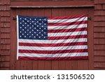Us Flag Displayed On Red Barn...