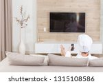 woman sitting on a couch with... | Shutterstock . vector #1315108586