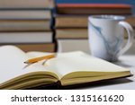 journal in library with mug | Shutterstock . vector #1315161620