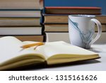 journal in library with mug | Shutterstock . vector #1315161626
