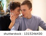 young couple in a cafe drinking ... | Shutterstock . vector #1315246430