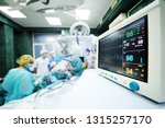 a group of surgeons operate on... | Shutterstock . vector #1315257170