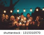 happy family celebrating with... | Shutterstock . vector #1315310570