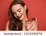 shy brunette woman with loose... | Shutterstock . vector #1315330076