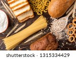 wheat products on dark wooden... | Shutterstock . vector #1315334429