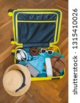 travel concept. yellow suitcase ...   Shutterstock . vector #1315410026