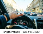 man driving car in city traffic....   Shutterstock . vector #1315410230