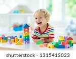 kid playing with colorful toy...   Shutterstock . vector #1315413023