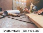 carpenter working with... | Shutterstock . vector #1315421609