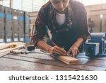 carpenter working with... | Shutterstock . vector #1315421630