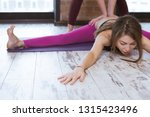 yoga instructor helps young... | Shutterstock . vector #1315423496
