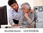 young man showing elderly lady... | Shutterstock . vector #131542826