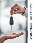 car dealer is giving keys to a... | Shutterstock . vector #1315448990