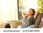 happy woman resting comfortably ... | Shutterstock . vector #1315487690