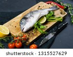 stuffed dorado fish on a wooden ... | Shutterstock . vector #1315527629