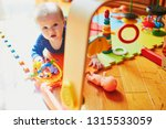 baby girl playing with toys on... | Shutterstock . vector #1315533059