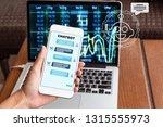 female hand holding mobile... | Shutterstock . vector #1315555973