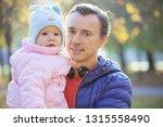 caucasian man and baby daughter ... | Shutterstock . vector #1315558490