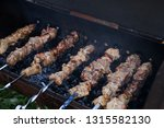 brazier with slices of pork... | Shutterstock . vector #1315582130