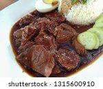 garlic beef with rice | Shutterstock . vector #1315600910