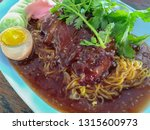 baked chicken noodles with sauce | Shutterstock . vector #1315600973