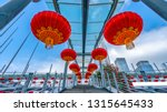 red lanterns hanging high in... | Shutterstock . vector #1315645433