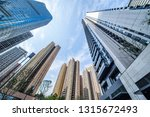 looking up at the city's dense... | Shutterstock . vector #1315672493