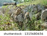 gabion   a metal wire cage... | Shutterstock . vector #1315680656