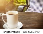 cup of hot coffee with smoke on ... | Shutterstock . vector #1315682240