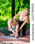 in the park  a yoga trainer... | Shutterstock . vector #1315739933