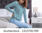 young woman suffering from back ... | Shutterstock . vector #1315781789