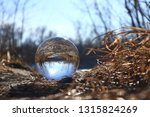 glowing lensball in nature | Shutterstock . vector #1315824269
