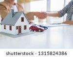real estate agent shaking hands ... | Shutterstock . vector #1315824386