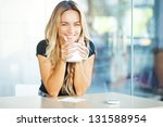 woman drinking coffee in the... | Shutterstock . vector #131588954