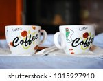 two cups of coffee on a white... | Shutterstock . vector #1315927910