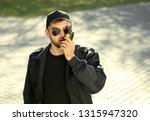 male security guard with... | Shutterstock . vector #1315947320