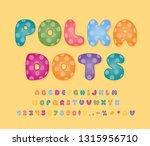 multicolor alphabet with polka... | Shutterstock .eps vector #1315956710