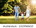 happy young couple spending... | Shutterstock . vector #1315960610
