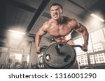 brutal strong athletic muscular ... | Shutterstock . vector #1316001290