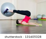 Pretty young woman fitness workout in gym with fitball - stock photo